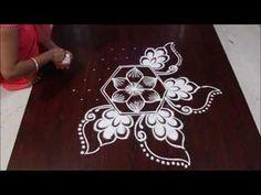 simple dots kolam 9 * 5 II easy dots rangolis II rangoli design - YouTube Best Rangoli Design, Rangoli Designs Latest, Latest Rangoli, Small Rangoli Design, Rangoli Kolam Designs, Colorful Rangoli Designs, Rangoli Designs Images, Beautiful Rangoli Designs, Rangoli With Dots