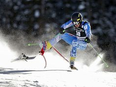 Andreas Zampa of Slovakia goes through a gate and loses a ski during first run of the men's giant slalom race in the FIS alpine skiing World Cup in Beaver Creek, Colo.  Erich Schlegel, USA TODAY Sports