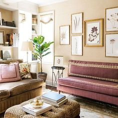 We love the sophisticated warmth of interior designer @catherinebradfordbugg's mix of plum and subtly neutral patterns in this living space. A gallery collection of @blackwell_botanicals pressed specimens completes the room.