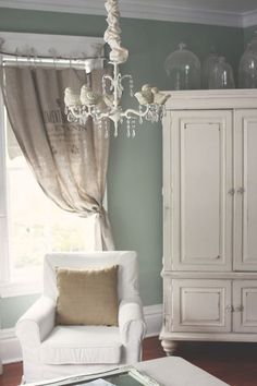 Behr's Frosted Bayberry, irresistible. There's enough green and gray in it to make it interesting, and as soothing as a bed of clouds. my bedroom walls. My sheers are white, the rug is a light beige Berber. My quilt is off white and mint green. I have a brass bed/mist gray furniture.