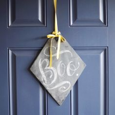 Make a chalkboard plaque to hang on your door and write a fun message to your guests!