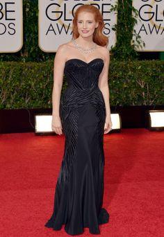 Jessica Chastain con  vestido strapless de silueta sirena negro de Givenchy by Riccardo Tisci.
