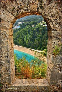 Valtos beach,seen through the walls of the venetian castle of Parga town Epirus Greece...foto by Hercules Milas
