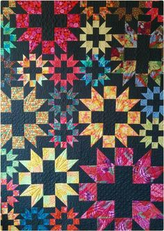 Star Plus quilt by Maria Dlugosch (Germany).  Fabric by Philip Jacobs & Kaffe Fassett.  The background is Kona charcoal. The pattern is by Claudia   Machen und Tun (Make and Do)