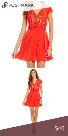 Gianni Bini Mistletoe Carina Dress Beautiful red orange Gianni Bini cocktail dress. Bodice features lace with nude lining. Skirt has sort of a grosgrain texture. This dress will get you noticed but is classy, very chic. Size S. Shell and lining- 100% Polyester / Outer- 70% Nylon, 30% Cotton. Gianni Bini Dresses Mini