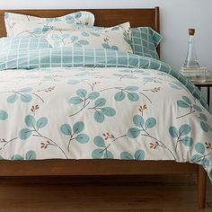 This contemporary-styled flannel duvet cover reverses from pale-blue check print to large-scale leaves, giving you two great looks to choose from.