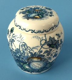 This is a vintage medium sized ironstone tea caddy or tea canister made by Masons, England in the 1940s in the Fruit Basket pattern in the blue transferware, polychrome, or multicolor colorway. The te
