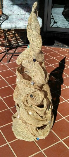 Burlap and buttons on Tomato Cage for Christmas Tree