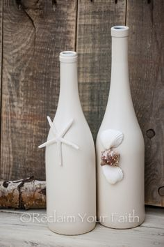 Wine bottle crafts! What a great idea using stone textured spray paint. Could use as candle holders or a vase. #crafts #winebottles