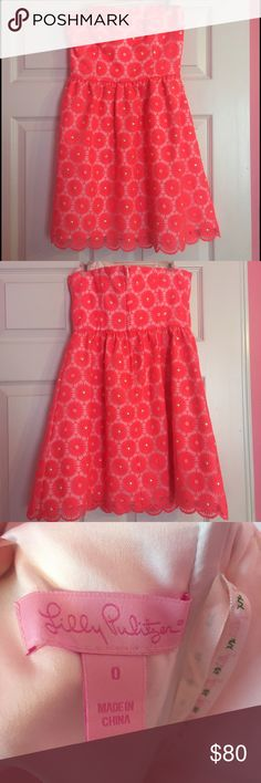Lilly Pulitzer Payton Fiesta Pink Pinwheel Dress Lilly Pulitzer Payton Fiesta Dress, size 0. Only worn a few times. There is a burn mark on one of the pinwheels shown in a picture, but barely noticeable when on due to how the dress lays. Lilly Pulitzer Dresses Strapless