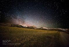 (my) Starry Night  I remember losing track of the number of shooting stars that would stream across the sparkling sky each night. I remember feeling like the size of an ant among them unfolding like a blanket above the mountain range I called home. Living in the city you are lucky if you see just one.    [Photographed in Springhill Community Belgrade Montana.]  Camera: Canon EOS 5D Mark III Lens: 14mm Focal Length: 14mm Shutter Speed: 114sec Aperture: f/2.8 ISO/Film: 3200  Image credit…