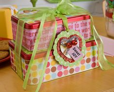 Decoupage cookie tins. A great way to revamp the not-so-pretty tins to personalize for special gifts.