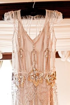Detailed decoration on a 20s wedding dress.
