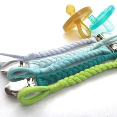 These Braided Pacifier Clips are very modern and gender neutral. Perfect for a boy or girl. They clip on easily to clothing or a car seat and come in cool colors: citron, teal, mint, ice mint, and ice blue.   #JerseyBraided #PacifierClips #LillyPillyBaby