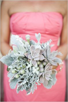 Succulent, brunia and dusty miller bouquet nicely complements the coral bridesmaid dress.