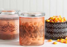 Martha Stewart Crafts - glass paint ideas for votives or hurricanes (pink/purple glass with gray/silver/gold flourishes)