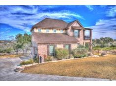 CANYON LAKE & HILL COUNTRY VIEWS FROM THIS 3/2.5, CUSTOM HOME ON 3.4 ACRES, LOCATED AT END OF CUL-DE-SAC. HIGH LIVING RM CEILING & FIREPLACE. LG KITCHEN W/ LIGHTED GLASS FRONT CABINETS, ISLAND & BREAKFAST BAR. SEPARATE 2ND LIVING AREA UPSTAIRS W/BALCONY. SCREENED BACK PORCH & LG DECK (SEE SITTING AREA/OPEN STORAGE UNDER DECK). LOT NEXT DOOR HAS SETBACK LINE SO AS NOT TO BLOCK YOUR LAKE VIEWS. ASK ABOUT FAB AMENITIES - RV PARKING, POOLS, LAKE FRONT PARKS, PAVILION, BALL COURTS.