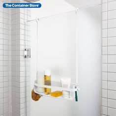Organize your bath essentials with the smart design of our Flex Single Shelf Caddy by Umbra. Its sturdy base and silicone band allows larger bottles to fit securely while three pour spouts allow you to turn almost-empty bottles upside down to get the most out of your product! Hanging Shower Caddy, Shampoo Bottles, Plastic Shelves, Shower Curtain Rods, Bottle Sizes, Plastic Molds, Bathroom Layout, Mold And Mildew, Shower Heads
