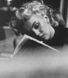Marilyn Monroe, reading. [A real and candid shot..]
