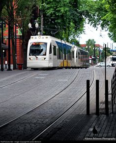 TriMet's MAX Red Line light rail service connects Portland International Airport, E/NE Portland, downtown Portland and Beaverton. Siemens S70 car 415 prepares to duck under the Burnside Street bridge. It is approaching the station stop at Skidmore Fountain, home of Portland's Saturday Market, the largest continuously operated outdoor market in the United States.
