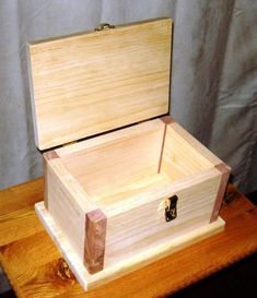 With the right plans, materials, and equipment, you can construct this simple wooden box, as shown here.http://www.woodworkingcorner.com/box.php