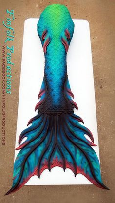 This one reminds me of my cousin Brandon (flames and blue fire and Greek fire) spent prob working on coloring this with the color fashion app(all the tails on this board basically) longest one ever but one of my favs Finfolk Mermaid Tails, Mermaid Fin, Mermaid Tale, Mermaid Room, Pretty Mermaids, Mermaids And Mermen, Magical Creatures, Fantasy Creatures, Realistic Mermaid Tails