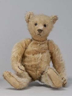 STEIFF BEAR Circa 1920  In blonde mohair, mostly missing. Shoe button eyes