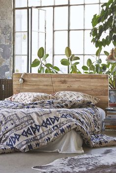 I really love the sheets-nice twist on usual white sheets! And the huge windows.