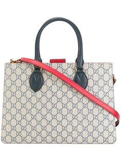 Shop Gucci GG Supreme tote.