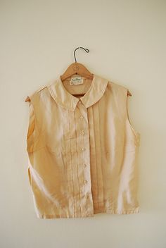 Recent Goodwill find- Silk/cotton blend with front tucks and covered buttons.Light cream with a beautiful sheen.