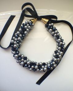Black and Grey Pearl Ribbon Tie Statement Necklace by LiliandCar on Etsy https://www.etsy.com/listing/256164749/black-and-grey-pearl-ribbon-tie