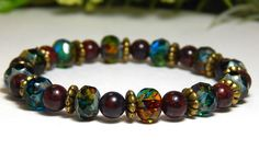 About the Bracelet An intriguing blend of dark red, topaz and teal combine beautifully to create this easy style boho chic bracelet. Bracelet Details: This beautiful gemstone bracelet is made with: -