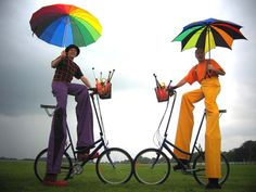 Stilts on bicycles! I am in love the umbrellas.