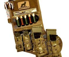 Tactical Christmas Stocking  Have Santa grant all your holiday wishes by having him fill up every nook and cranny of the tactical Christmas stocking. With features like a metal clip six strips of MOLLE and a rack for shotgun shells its the ideal way for any military veteran to spread a little holiday cheer.  $24.99  Check It Out  Awesome Sht You Can Buy