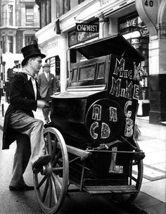 Organ Grinder, Shaftesbury Ave, Piccadilly, by Israel Bidermanas - 'Charmes de Londres' London Pictures, London Photos, London History, British History, Vintage London, Old London, London Life, London Street, Old Photos