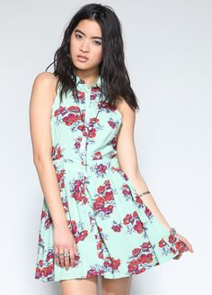 ca401c1aa13 Sleeveless shirt dress featuring red and blue floral details