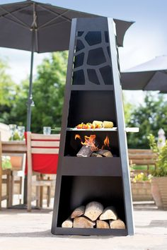 This chimenea has everything you need to entertain guests in your garden. The chimenea acts as a patio or garden heater and comes complete with BBQ grill to enable you to cook for your guests and family. The chimenea has a log store at the bottom to prevent you having to keep collecting wood from your store. This chimenea has a modern cut out design which is particularly impressive at night when the glow of your fire shines through.