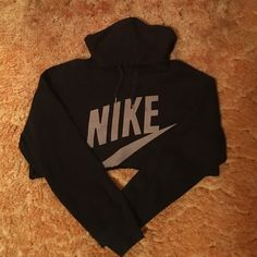 Vintage Nike Cropped Sweatshirt Vintage Nike cropped black hooded sweatshirt. Size large but runs very small! Tops Sweatshirts & Hoodies
