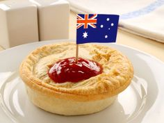 A recipe for Aussie Meat Pie (Four and Twenty) made with flour, salt, water, beef drippings, puff pastry, egg, beef, beef bouillon cube, black