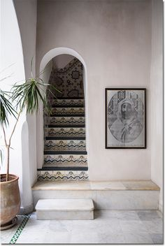 A tiled staircase is balanced by a vintage black-and-white portrait | domino.com
