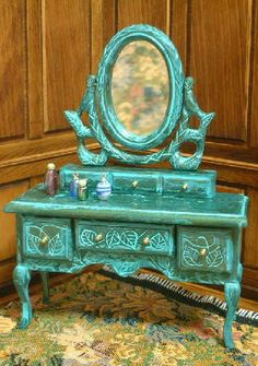 how to: carved dressing table - just a regular wooden kit that has details carved by the owner. Very interesting