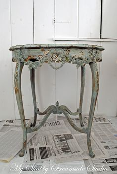 Tutorial for creating this Faux Finish using Crackle Medium, Chalk Paint and a Paraffin Wax Candle + How to create Faux Plaster Floral embellishments (like the one on the front of this table) using Plaster, Spray Paint & Silk Flowers.