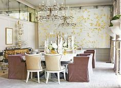 A dramatic showhouse dining room features a large bird mural by Thomas Swanston - Traditional Home® / Photo: Emily Followill / Designer: Melanie Turner