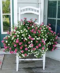 Cut a hole in the seat of an old chair and place a pot of wave petunias. Another great chair idea. I am running out of chairs. Garage sales here I come!}}} Cut a hole in the seat of an old chair… Garden Chairs, Garden Planters, Garden Furniture, Container Plants, Container Gardening, Flower Containers, Old Chairs, Dining Chairs, Garden Types