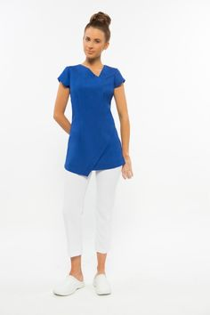 Abstract hem line and neck line, zips at the rear with cap sleeves Cool easy wash and wear corporate grade fabric with a gentle stretch. Bleach resistant and no ironing Black, navy, white, Charcoal grey, dove grey, hot pink & electric blue Sizes 4-28 Click here to view Size Chart