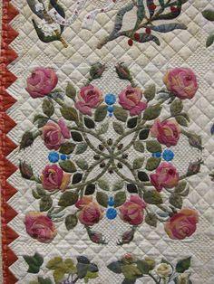 """Closeup of """"Mi Amor"""" by Margarete Heinisch 87"""" x 87""""  Hand and machine pieced, hand appliqued, hand quilted.  Original design."""
