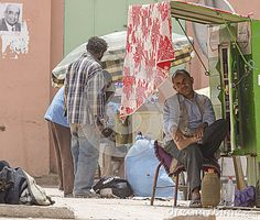 Muslim man on th side dirty and destroyed street  citie Taroudant in Morocco