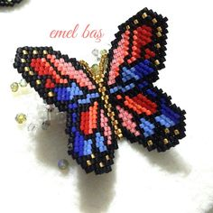 Brick stitch butterfly pendant by Emel Bas from Turkey
