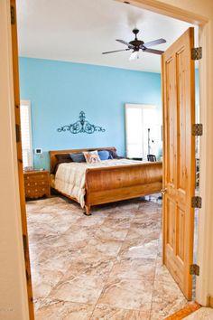 Double 8' alder doors open onto the master suite. http://teamwoodall.com/lunabella/