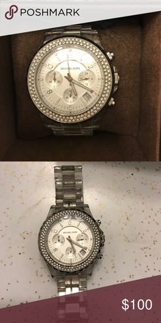 Michael Kors silver acrylic watch w diamonds Authentic Michael Kors acrylic watch with diamonds on face. Acrylic band is a bit dirty and could use a cleaning but doesn't affect the watch. Original box and links included. Batteries in working condition. Michael Kors Accessories Watches
